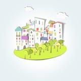 村庄、森林和色的屋顶 免版税库存照片