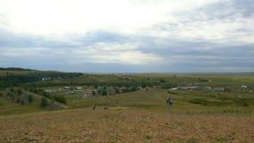 村庄在山和草在一个山区,小解决高地的 库存照片