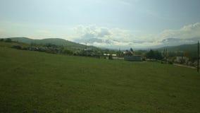 村庄在春天的山麓小丘 股票视频