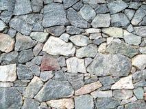 束大花岗岩向水平的图片扔石头 免版税图库摄影