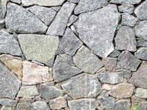 束大花岗岩向水平的图片扔石头 免版税库存照片