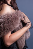 束腰佩带的妇女 免版税库存图片
