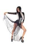 束腰和脚跟的美丽的妇女 图库摄影