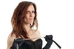 束腰和链子的妇女 免版税库存图片