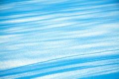 条纹从雪的纹理背景 库存照片