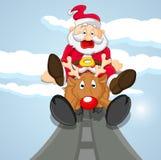 来在驯鹿的滑稽的圣诞老人 免版税图库摄影