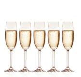 杯与泡影的香槟,被隔绝  免版税库存图片