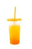 杯在塑料的橙汁 库存照片
