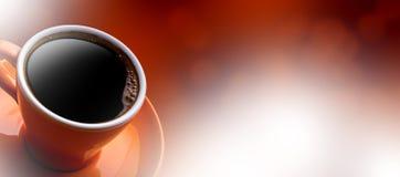 杯在bokeh背景的无奶咖啡 免版税库存照片