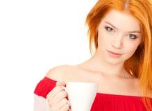 杯子逗人喜爱的红头发人白色 库存图片