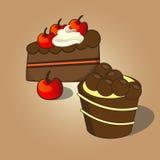 杯形蛋糕和巧克力蛋糕顶部用樱桃 免版税库存照片