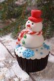 杯形蛋糕圣诞节雪人 库存图片
