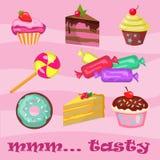 杯形蛋糕新月形面包油炸圈饼甜点和曲奇饼的汇集 免版税图库摄影