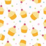 杯形蛋糕无缝的样式。 免版税库存图片