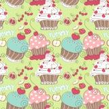 杯形蛋糕无缝的模式 免版税库存图片