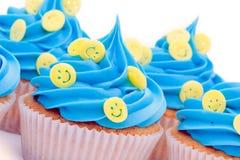 杯形蛋糕表面面带笑容 图库摄影