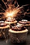 杯形蛋糕闪烁发光物 免版税库存照片