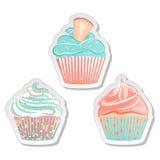 杯形蛋糕贴纸,食物在淡色的标号组 图库摄影