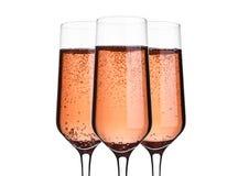 杯桃红色与泡影的玫瑰香槟在白色 库存照片
