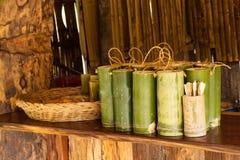 杯水由竹子被做 免版税库存照片