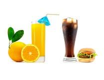 杯苏打用汉堡包和一杯新鲜的橙汁用在白色隔绝的切的桔子 免版税库存图片