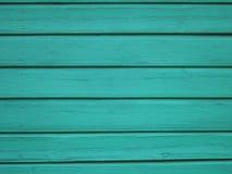 绿松石木背景-书桌桌墙壁或地板的被绘的木板条 免版税库存图片