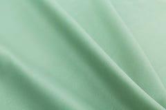 绿松石背景豪华布料或难看的东西丝绸纹理缎波浪折叠  免版税库存照片
