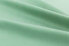 绿松石背景豪华布料或难看的东西丝绸纹理缎波浪折叠  免版税库存图片