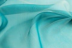 绿松石背景豪华布料或难看的东西丝绸纹理缎波浪折叠  库存图片