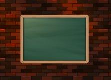 黑板在砖样式纹理墙壁上的背景模板 图库摄影