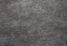 板料浓厚,在深灰颜色的粗糙地被编织的织品 文本 免版税库存图片