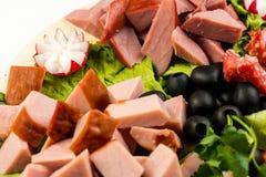 板材板用肉和乳酪 在意大利样式的宴会 免版税库存图片