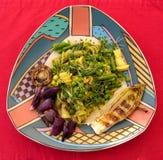 板材用烤食物和面团在红色背景 免版税图库摄影