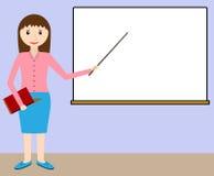 黑板的女老师 免版税库存照片