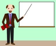 黑板的男老师 免版税库存照片