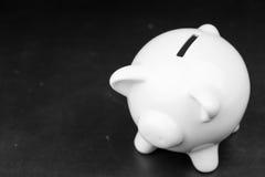 黑板的白色存钱罐 免版税库存图片