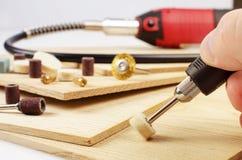 板刻研磨机和辅助部件 免版税库存图片