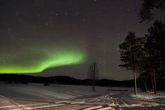 极光Borealis在Inari,拉普兰,芬兰 免版税图库摄影