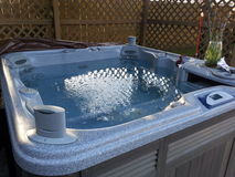 极可意浴缸温泉天 库存照片