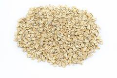 极少数在白色背景的大燕麦剥落 图库摄影
