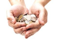 极少数硬币在棕榈手上 免版税库存图片
