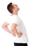 极度痛苦的人充满背部疼痛 免版税库存图片