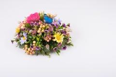 构成由人造花、果子、蝴蝶、麦子的鸟和耳朵制成 图库摄影