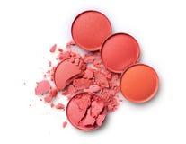 构成的圆的橙色被碰撞的眼影膏作为化妆产品样品  免版税库存图片