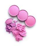 构成的圆的紫色被碰撞的眼影膏作为化妆产品样品  免版税库存照片