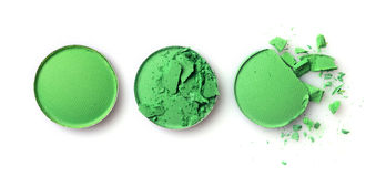 构成的圆的绿色被碰撞的眼影膏作为化妆产品样品  库存照片