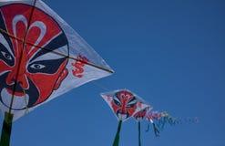 构成风筝中国传统京剧样式在天空的 免版税库存图片