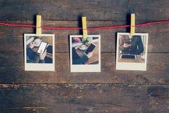 构筑使用电话机的照片妇女垂悬在晒衣绳 库存照片