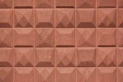 构造有面包屑砖颜色方形的平板的墙壁  火炮 免版税库存图片