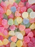 果冻各种各样的颜色橘子果酱糖果在宝石形状的  生动的多彩多姿的调色板橙黄色绿色红色桃红色蓝色 模式 免版税库存照片